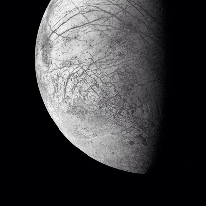 Europa - one of Jupiter's dozens moons - has a an icy surface filled with sprawling faults and deep flowing ridges.