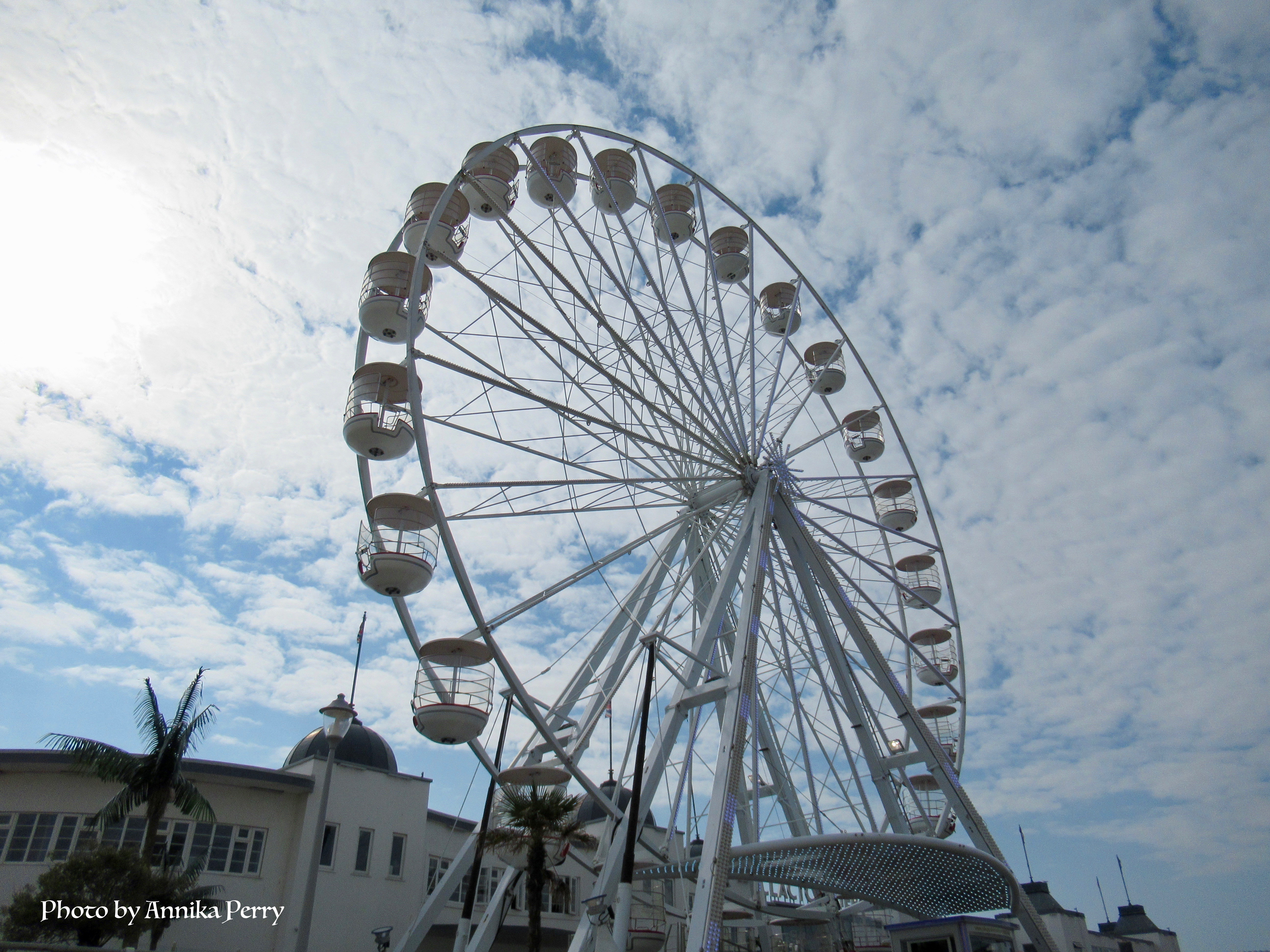 """""""Big wheel ride taken from below against white wispy clouds. Shows its dramatic height."""""""